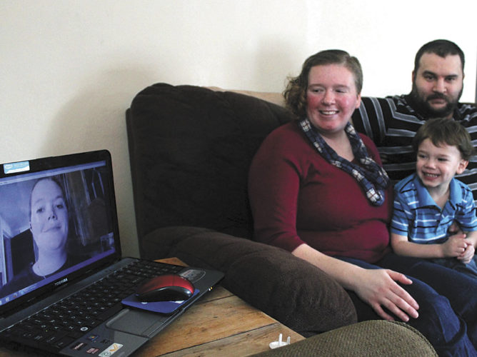 From left, are Ashley Faulk and Norway residents Amy and Mike Lippert with son Benjamin, age 4. Faulk, of Indiana, who is Amy Lippert's sister and Benjamin's biological mother, Skypes often with the family.