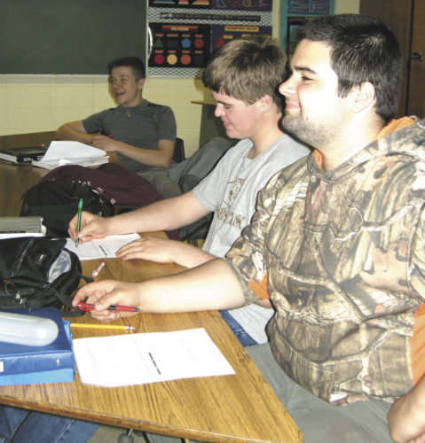 Goodman-Armstrong Creek High School has earned state recognition and will receive an award during a ceremony in Madison on Monday. The school was designated as a Beating-the-Odds School with noted achievement in reading and mathematics. From left, are students in Autumn Crago's trigonometry class, juniors Stanley Kessel, Jared Knutson, and Trevor Kalkofen.