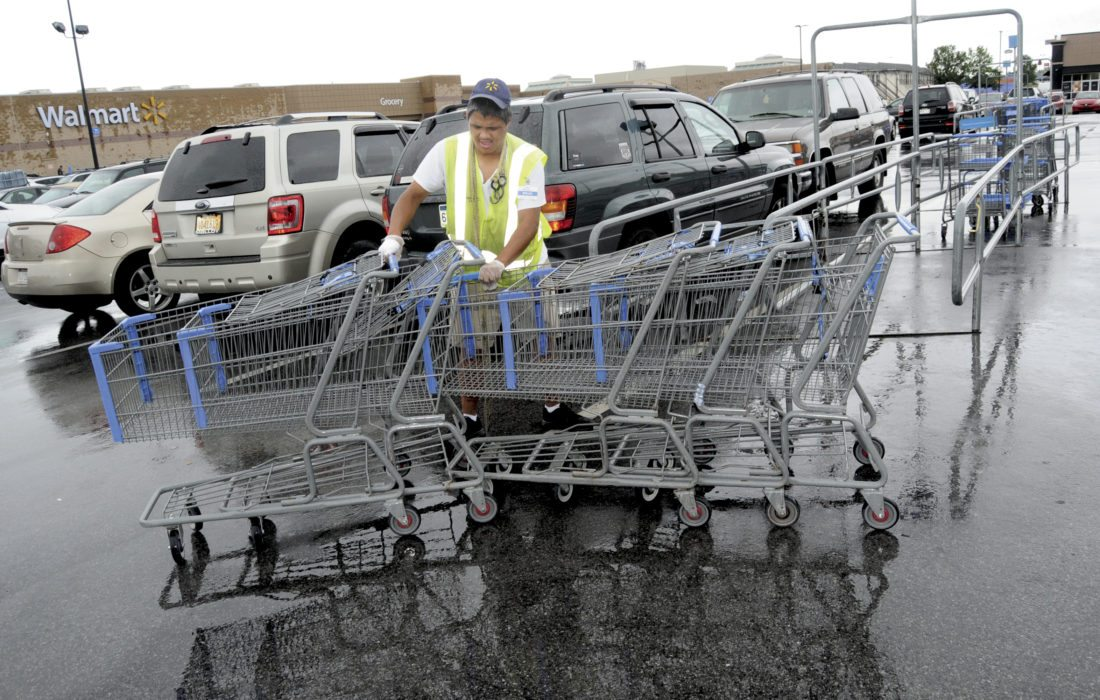 30 Rainy Day ra 09-29-16 Brian Shuttlewood gathers up shopping carts in the Walmart parking lot in at the Foxcroft Towne Center despite the rain Thursday afternoon. (Journal Photo by Ron Agnir)