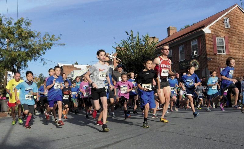 Journal file photo by Ron Agnir Runners take off from the start of the 5K at a past Freedom's Run. The eighth annual event will be held Saturday in Shepherdstown. Events include 5K, 10K, half-marathon and marathon runs.