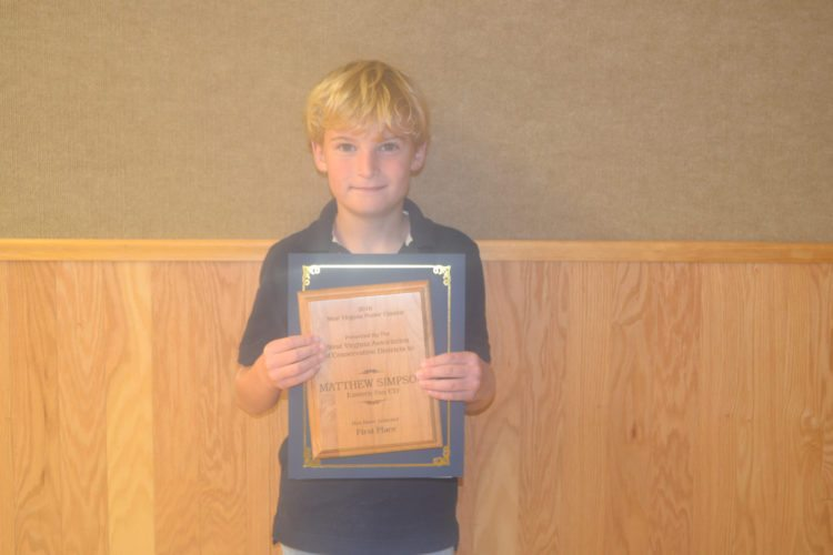 Matthew Simpson won the 2-3 grade category and his poster also won first place at the state level.