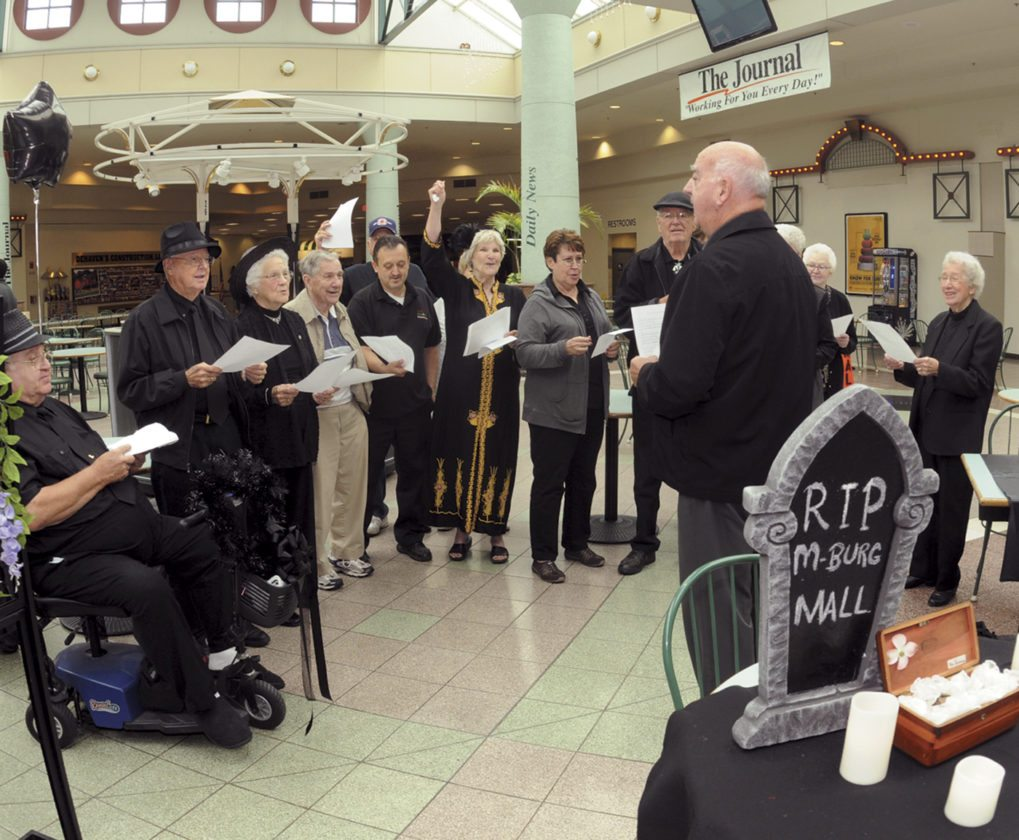 "Journal photos by Ron Agnir ""The Lunch Bunch"" sing at a wake vigil for the upcoming closure of the Foxcroft Towne Center, formerly known as the Martinsburg Mall, on Friday afternoon. The group has been meeting since the mall opened in 1991."