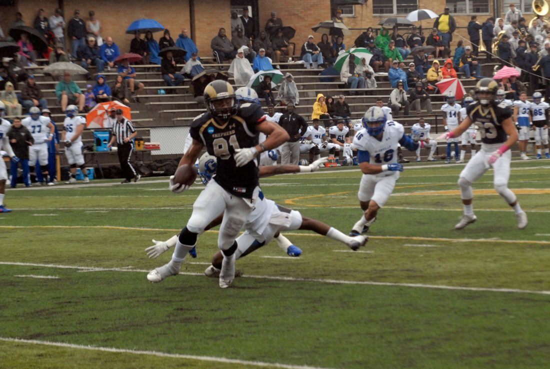Journal photo by Rick Kozlowski Shepherd wide receiver Billy Brown breaks a tackle during the Rams' win over Glenville State on Saturday in Shepherdstown