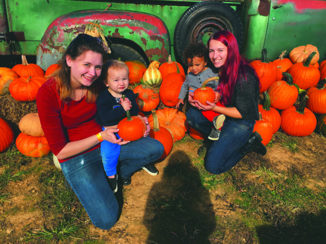 Above, Andera Snow, left, and her son Troy Snow pose for a photo with Kaylie Keener and her son Aayden Gordon at Orr's Farm Market on Tuesday.
