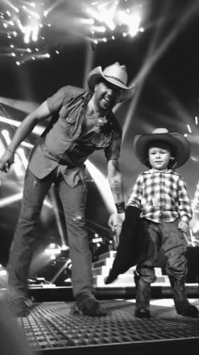 Submitted photos Trey Hockensmith, 3, of Martinsburg, shares the stage with country singer Jason Aldean on Oct. 1 at Jiffy Lube Live.