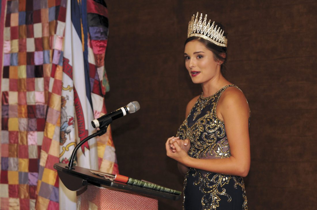 Journal photo by Ron Agnir Keara Alexandrea Heck, Queen Pomona XXXVI, recites her farewell address as the final act of her reign at the Mountain State Apple Harvest Festival Gala on Thursday evening at the Hollywood Casino ballroom in Charles Town.
