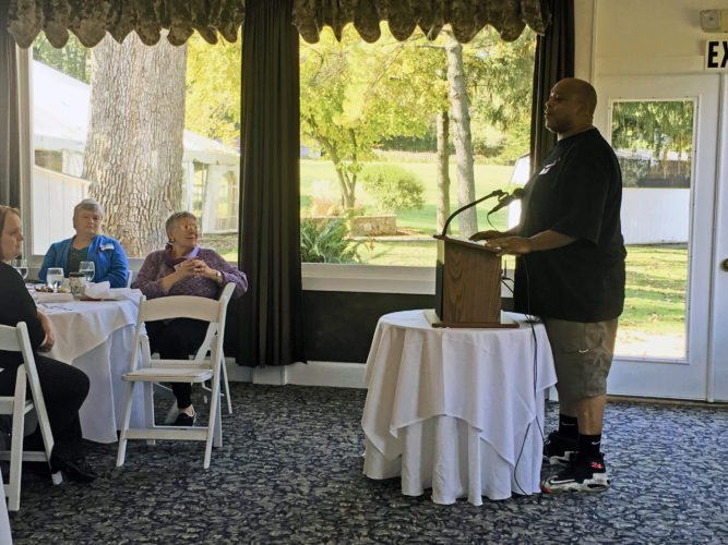 Journal photo by Katiann Marshall Stephan Christian, who has participated in the Community Alternatives to Violence program, speaks at the organizations annual luncheon Thursday afternoon at the Purple Iris in Martinsburg.