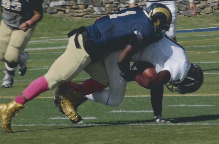 Journal photo by Rick Kozlowski Shepherd linebacker James Gupton makes a tackle during the Rams' contest against Concord on Saturday in Shepherdstown. Shepherd won 21-7, improving to 7-0.