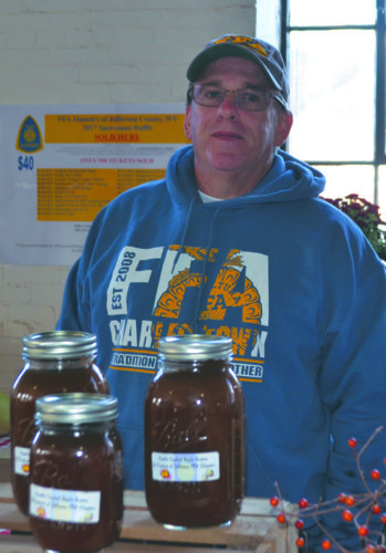 Journal photo by Mary Stortstrom Bill Nicewarner displays apple butter Saturday at the Mountain State Apple Harvest Festival craft show.