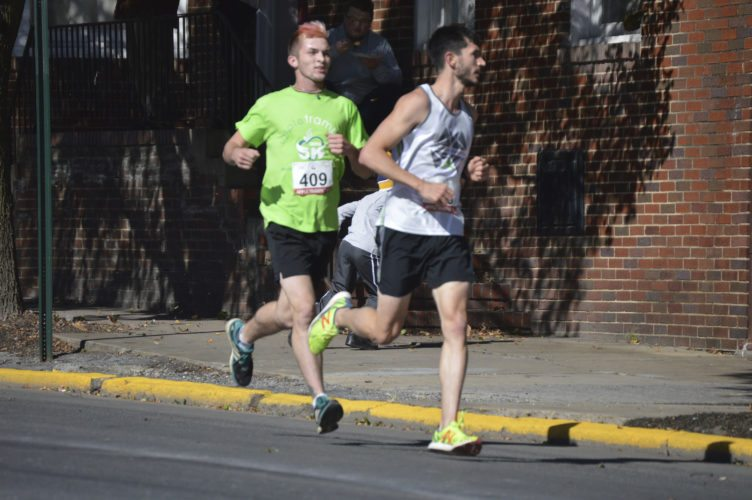 Journal photo by Jessica Manuel Daniel Beavers, left, defended his Apple Trample 5k title during the event on Saturday in Martinsburg.
