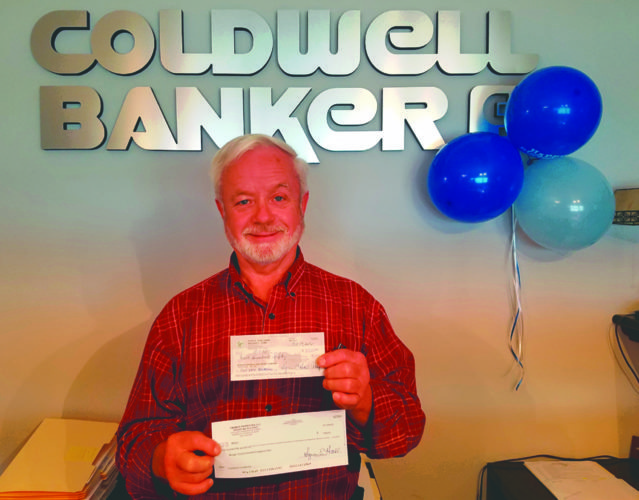 Submitted photo Coldwell Banker Realtor Bob Dugan with donation checks that will be presented to Morgan County InterFaith Emergency Care.