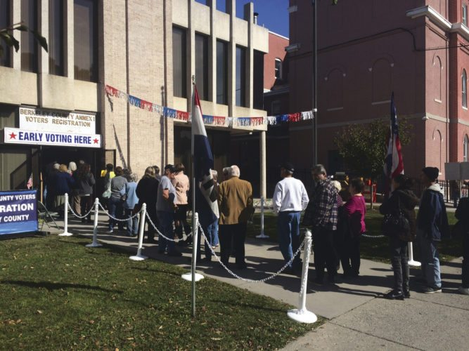 Journal photo by Matt Dellinger Many people wait in line outside the Berkeley County voters registration office on Wednesday.