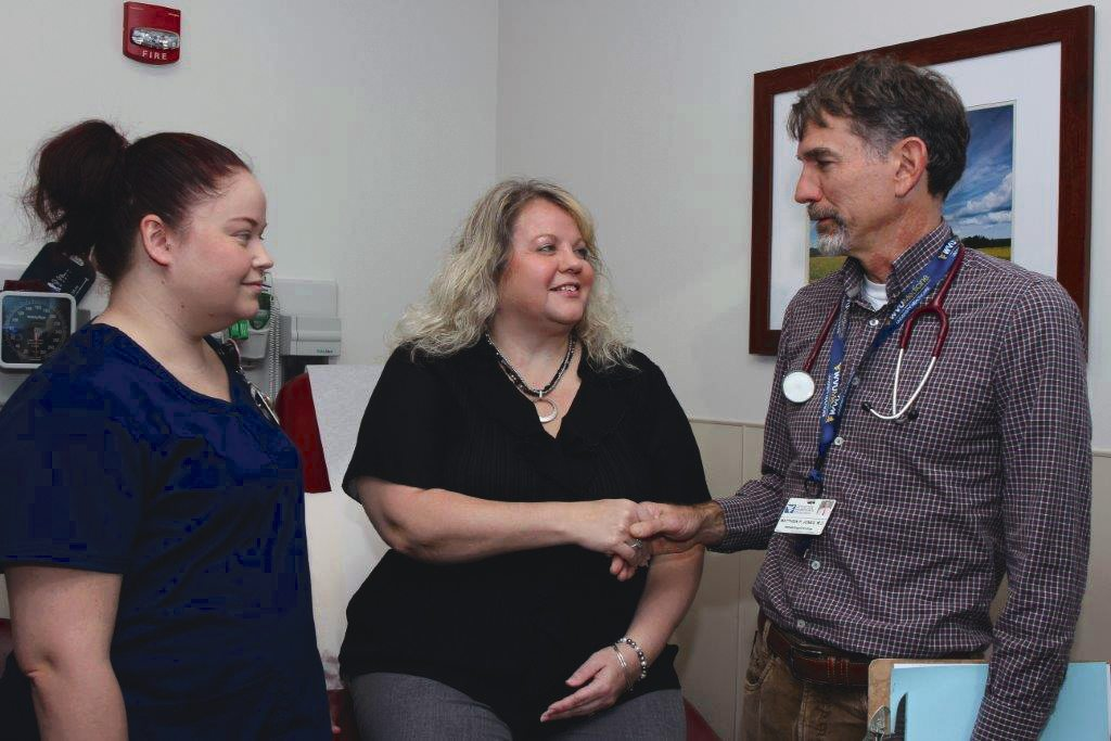Submitted photo Samantha Searing BSN, RN, breast nurse navigator, left; and Matthew Page Jones, right, discuss oncology options with a patient at the WVU Medicine Cancer Center in Martinsburg.