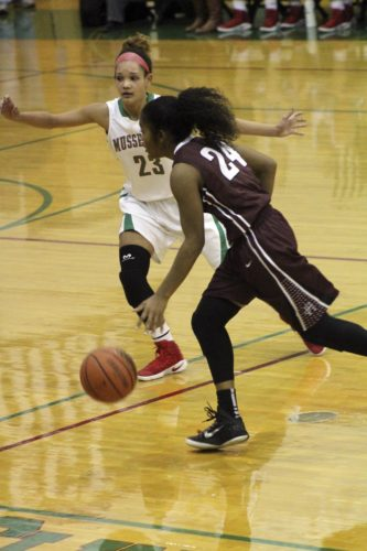Journal photo by Brooke?Reaves Musselman's Janaia Fargo, back, defends Handley's Taneisha Walker during their game on Thursday.