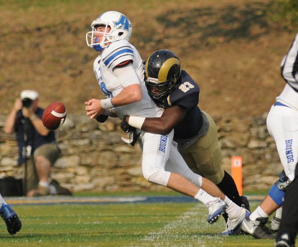Above, Shepherd's Bruno Anyangwe sacks Assumption's Marc Monks and forces a turnover during second-quarter action of their NCAA Division II playoff game on Nov. 19, 2016 in Shepherdstown. Below, Shepherd's C.J. Davis, left, races past Assumption's Andrew Benson on his way to a touchdown in the third quarter. The Rams take on California (Pa.) today in the quarterfinals.