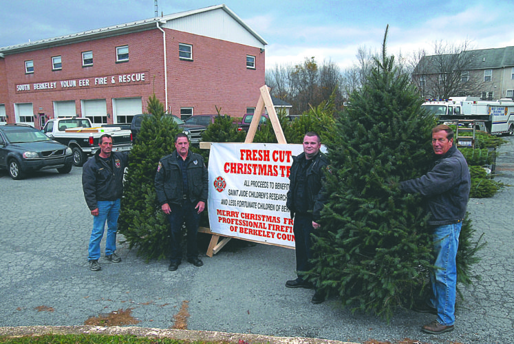 (Journal photo by Jeff McCoy) Shown, from left, are Thomas Presley, Rick Petry, Steve Shawyer and Captain Eddie Gochenour as they man the Christmas tree sales lot at the South Berkeley Volunteer Fire Department on Friday. The department is selling Christmas trees to raise funds for St. Jude Children's Hospital and the Berkeley County Backpack Program.