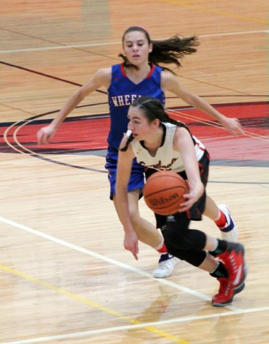 Spring Mills' Sydney Shaw dribbles against the Wheeling Park defense during Saturday's game in Spring Mills.