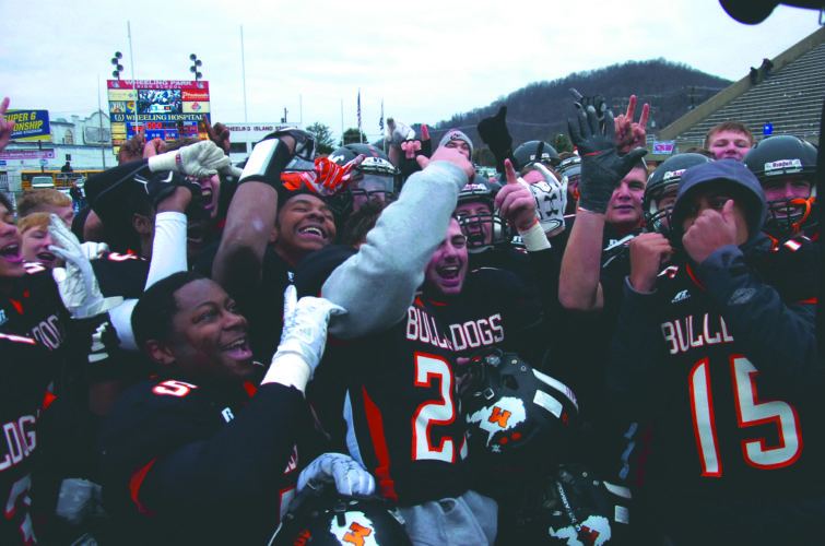 (Journal photo by Eric Jones) The Martinsburg Bulldogs celebrate their win over Spring Valley High on Saturday in Wheeling.