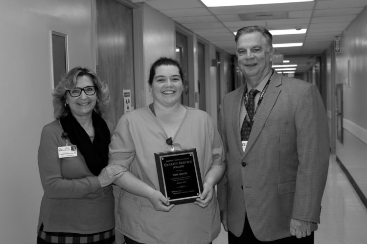 Submitted photo Sara Glaves, WVU Medicine Berkeley Medical Center's August Quality Service Award winner is pictured receiving her award. Presenting the award are Lynette Dalton, director of cardiovascular services, left and Anthony P. Zelenka, hospital president and CEO.