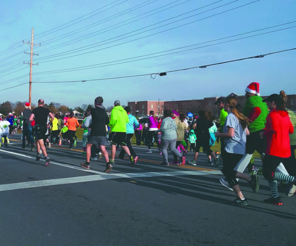 Journal photos by Danyel VanReenen Participants in the 6th annual South Berkeley Christmas 5K race begin their 3.1 mile trek Sunday in Inwood.