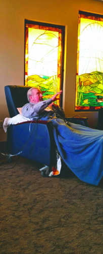 """Submitted photo Buddy Trabert performs at Hospice of the Panhandle's inpatient unit's chapel. Trabert sang """"10,000 Angels Cried"""" and """"Go Rest High on That Mountain."""""""