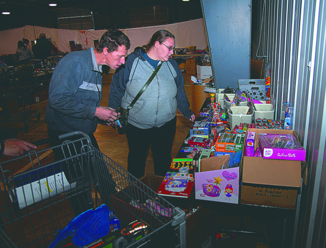 (Journal photo by Jeff McCoy) Jessica Coffin and Warren Kenter shop for Christmas presents Monday at the Toys for Tots distrobution center at the Berkeley County Fairgrounds in Martinsburg.