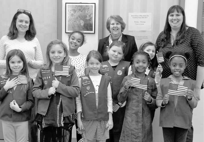 (Submitted photo) Brownie Troop 40436 greets new citizens recently with American flags.