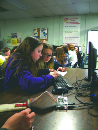(Journal photo by Jim McConville) Two Hedgesville Middle School sixth-graders create a program file Tuesday during Computer Science Education Week in Hedgesville.