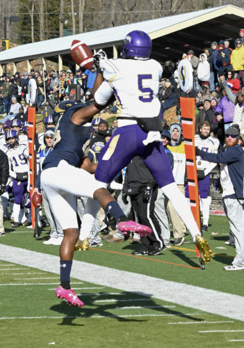 Photo by David Pennock Shepherd's Adam Coles, left, breaks up a pass intended for North Alabama's Julius Jones during Saturday's NCAA Division II national semifinal game in Shepherdstown.
