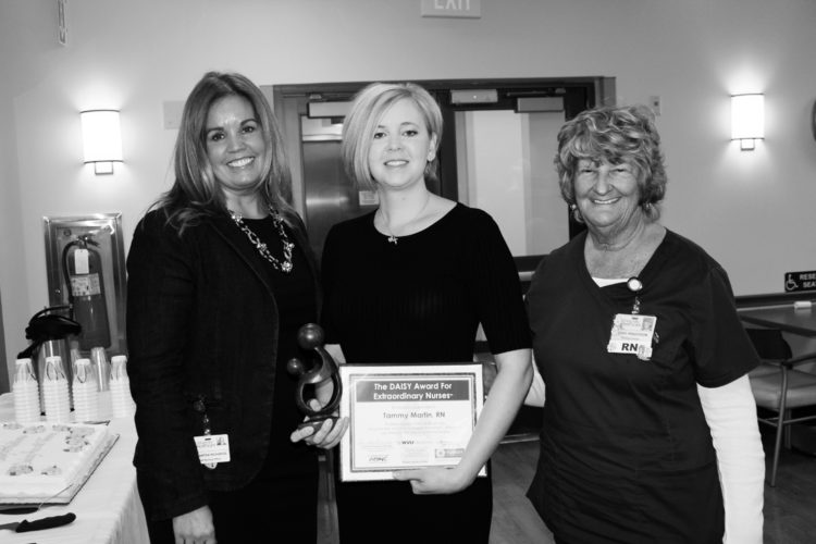 Submitted photo WVU Medicine Berkeley Medical Center's third quarter 2016 recipient of the DAISY Award For Extraordinary Nurses Tammy Martin, center, is pictured receiving her award from Samantha Richards, left, vice president/chief nursing officer at WVU Medicine University Healthcare and Jeanne Henderson, oncology nursing director.