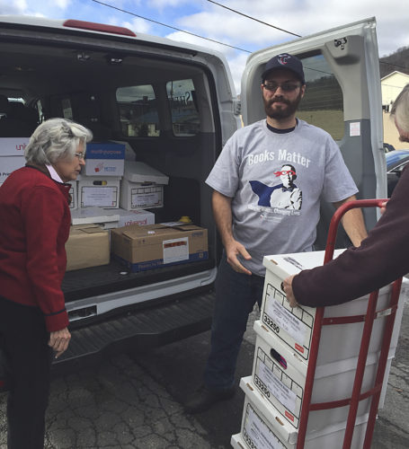Submitted photo Forty three boxes were delivered to Rainelle Public Library as a gift from Shenandoah University to help replace the 12,000 books lost in the recent Greenbrier County floods.