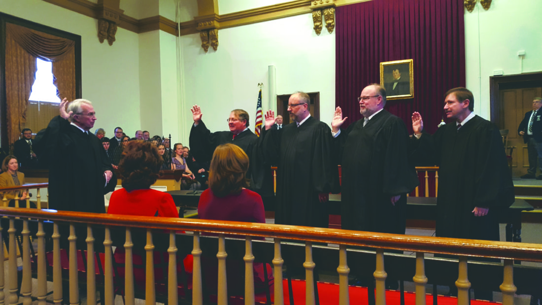 (Photo by Jennifer R. Young) West Virginia Supreme Court of Appeals Justice Menis E. Ketchum II swears in the four returning 23rd district circuit court judges, from left, are John C. Yoder, Michael D. Lorenson, Christopher C. Wilkes and Gray Silver III, Wednesday in Charles Town.