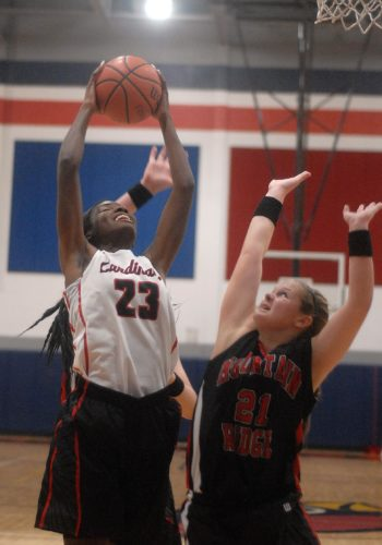 Journal file photo by Jessica Manuel Spring Mills' Sydnei Taylor, left, puts up a shot as Mountain Ridge's Tessa Lutton defends during Tuesday night's game in Spring Mills.