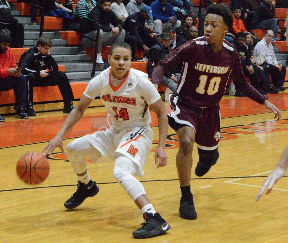 Martinsburg's Braxton Wright, dribbles as Jefferson's Sequoia Gerrard defends during Tuesday's game in Martinsburg. See more photos on CU.journal-news.net. (Journal photo by Jessica Manuel)