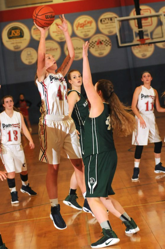 Journal photo by Ron Agnir Washington's Kayla Reifke shoots over Hampshire's MacKenzie Hartman (44) during third-quarter action Tuesday evening. See more photos on CU.journal-news.net (Journal photo by Ron Agnir)