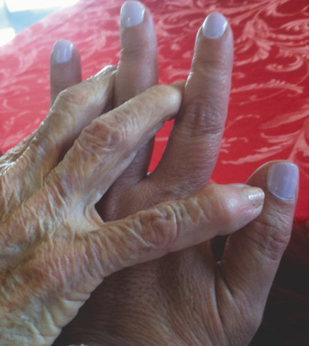 (Submitted photo) Take a photo of only a portion of a subject and let the viewer fill in the missing parts like this photograph of a mother's and daughter's hands.