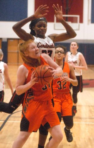 Journal Photo by Eric Jones Musselman's Janaia Fargo, middle, dribbles between Jefferson defenders Amari Wooden, left, and Leah Logan during third-quarter action Thursday evening in Inwood. See more photos on CU.journal-news.net. (Journal photo by Ron Agnir)