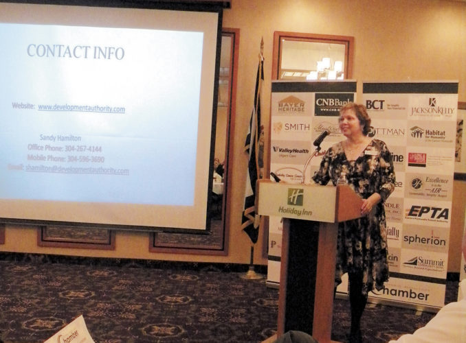 (Journal photo by Jim McConville) Sandy Hamilton, Berkeley County Development Authority executive director, speaks to the Martinsburg- Berkeley County Chamber of Commerce on Friday.