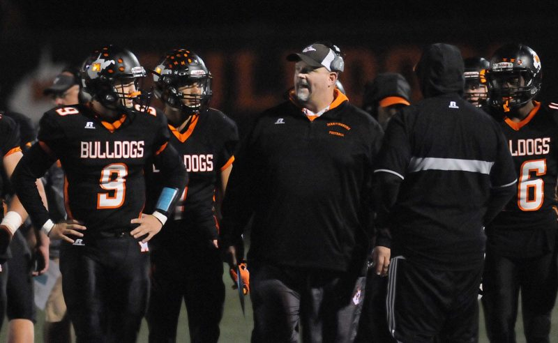 Journal photo by Ron Agnir Martinsburg football coach David Walker, right, was named National Federation of State High School Associations Coaches Association national coach of the year.
