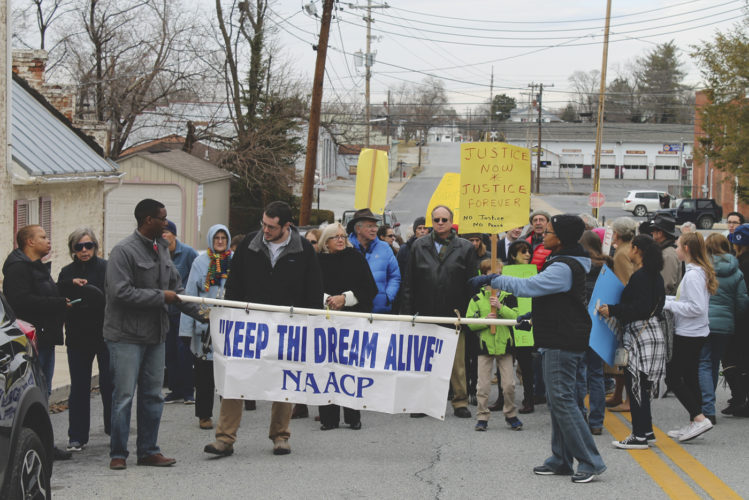 (Journal photo by Danyel VanReenen) Members of the NAACP hosted a peaceful march in honor of Dr. Martin Luther King Jr.'s life on Sunday in Charles Town. Marchers lined up to walk down Washington Street.