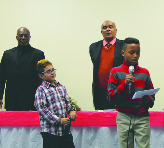Journal photo by Danyel VanReenen The Jefferson County Black Clergy Association hosted a Martin Luther King Jr. celebration at the Independent Fire Hall in Ranson on Monday morning where William Smith and Justin Brown read Bible verses to attendees.