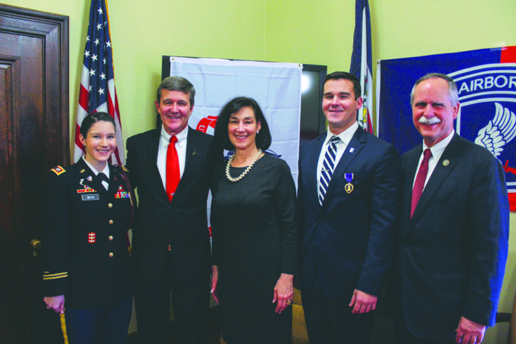 Submitted photo Retired U.S. Army Capt. Steven Warner, second from right, receives the Purple Heart during a ceremony Monday in Charleston. With him, from left, are his sister, U.S. Army Capt. Lisa Warner Miller; his father, West Virginia Secretary of State Mac Warner; his mother, Debbie Warner; and U.S. Rep David McKinley, R-W.Va.
