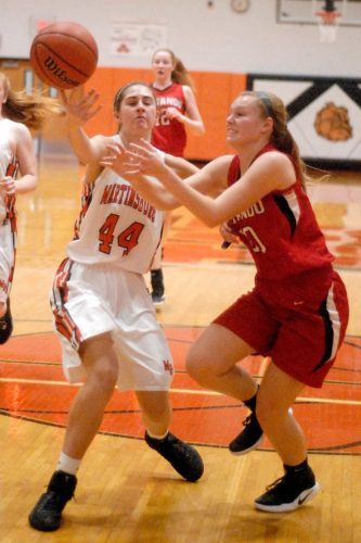 Martinsburg's Morganne Andrews, left, knocks the ball loose from Sherando's Kelli White during Wednesday's game in Martinsburg. See more photos on CU.journal-news.news.net (Journal photo by Eric Jones)