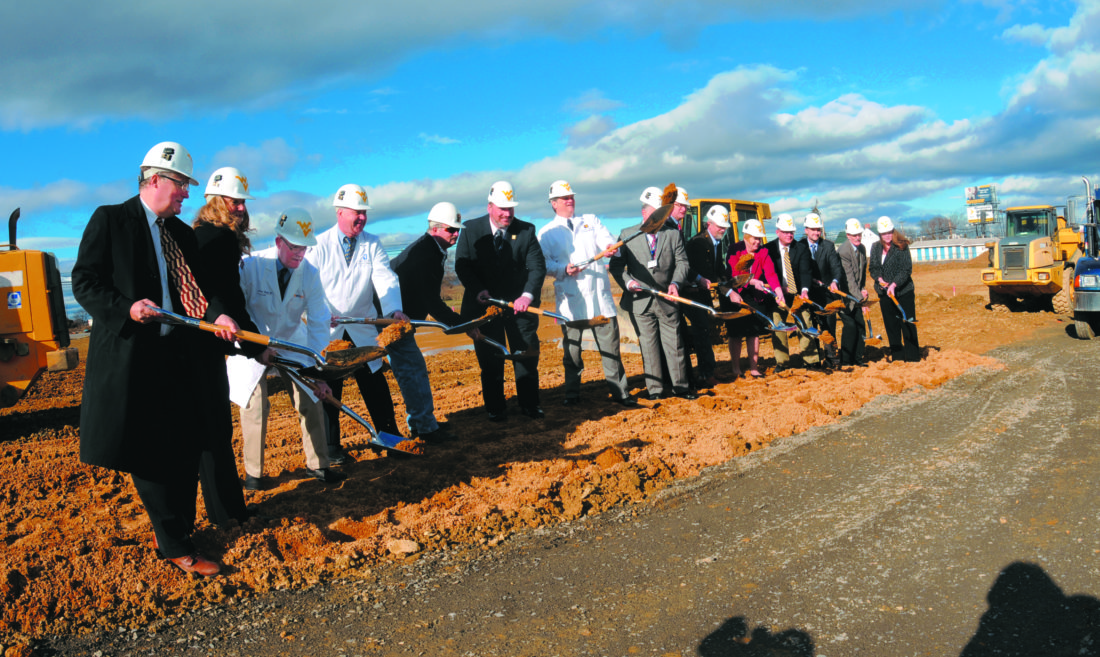 Journal photo by Ron Agnir Taking part in the groundbreaking for the Spring Mills MedicalOffice are Matthew Grove and Lisa Dall'Olio, Grove &Dall'Olio Architects; Dr. JeffreyStead, UHPBoard of Directors; Dr. George Harris, Medical Director, UHPPrimary Care Clinics; Steve Mixell, Brechbill &Helman Construction; Aaron Henry, vice president of operations/CEO, WVU Medicine University Healthcare Physicians; Konrad C. Nau, president/CEO, WVU Medicine University Healthcare Physicians; Anthony P. Zelenka, president/CEO, WVU Medicine University Healthcare; David DeJarnett, WVU Medicine University Healthcare board of directors; Dan Dulyea, Berkeley County Council; Tina Combs, Martinsburg Chamber of Commerce; Tim Pownell, United Bank; Josh Householder, Bank of Charles Town; Delegate John Overington; and Kathleen Stotler, representative of Sen. Shelley Moore Capito, R-W.Va.
