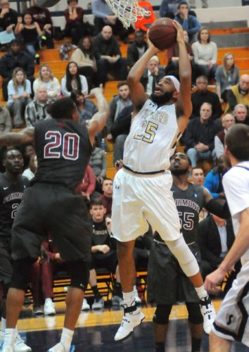 Shepherd's AJ Carr, right, goes up strong in the paint against Fairmont State's Thomas Wimbush during the first half Thursday evening in Shepherdstown. (Journal photo by Ron Agnir)