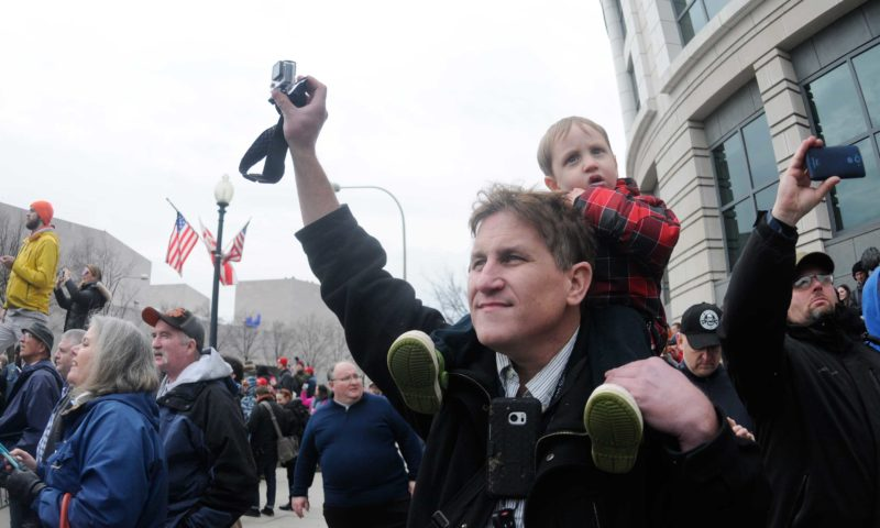 (Journal photo by Ron Agnir) Oliver Reiss, 3, and his dad, Walter Reiss, both of Bethlehem, Pennsylvania, stand among the crowd using a GoPro to document the moment President Donald Trump took the oath of office Friday at noon in Washington.