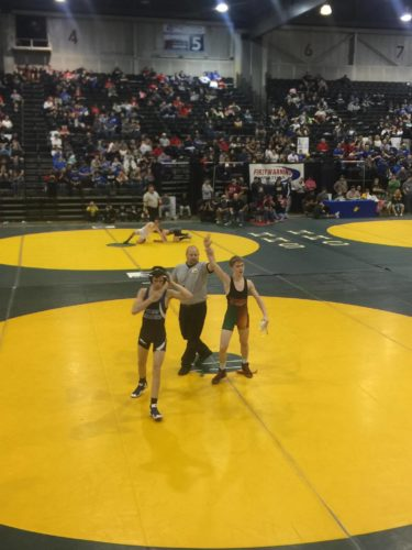 Above, Mountain Ridge's Cody Shindledecker, right, has his hand raised after winning the individual title at the WSAZ Middle School Invitational in the 116-pound pound weight class over the weekend. Below, Shindledecker wrestles against Angelo Manzo of West fairmont in the WSAZ finals.