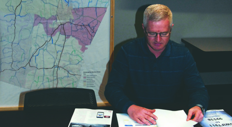Journal photo by Jeff McCoy Randy Lilly, emergency manager at Berkeley County Homeland Security & Emergency Management, reviews the SWIFT 911 options which will introduce a mass notification system to Berkeley County.