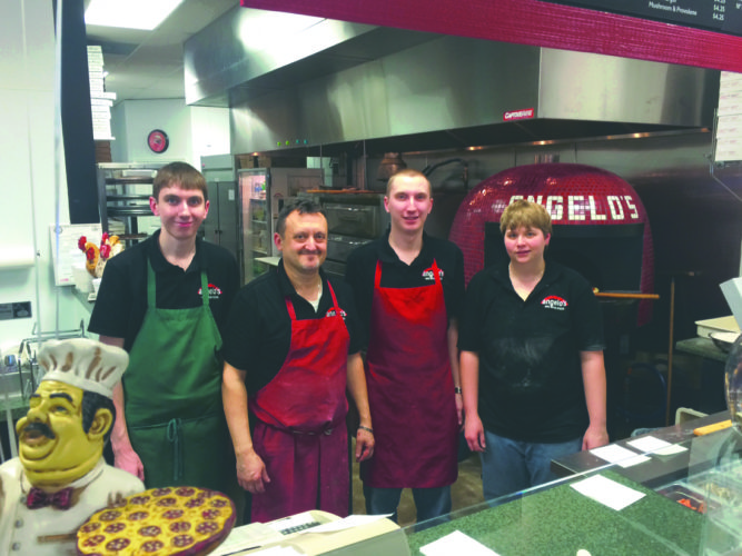 Journal photo by Matt Dellinger Jacob Westfahl, Lino Dagostino, Zach Westfahl and Sam Row take a break to pose inside Angelo's Red Brick Pizza.