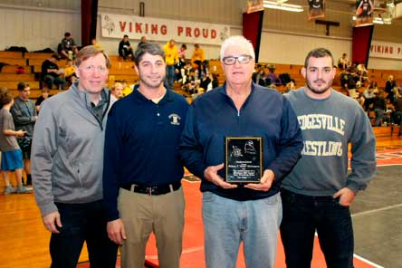 Photo by Carl Holcomb, Moorefield Examiner Joined by his staff, Hedgesville wrestling coach Bill Whittington (second from right)  is honored for winning is 600th career match on Friday at Petersburg. His assistant coaches include (from left) Robert Jarrett, Matt Forte and John Cardello.